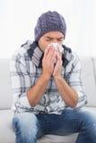 Sick man sneezing Royalty Free Stock Photography