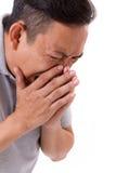 Sick man sneezing Royalty Free Stock Photos