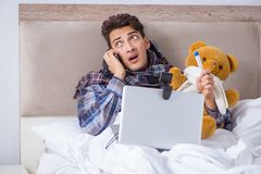 The sick man suffering from flu in the bed. Sick man suffering from flu in the bed Royalty Free Stock Photo