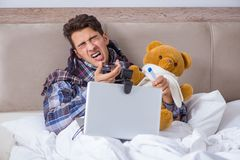 The sick man suffering from flu in the bed. Sick man suffering from flu in the bed Stock Image