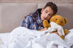The sick man suffering from flu in the bed. Sick man suffering from flu in the bed Royalty Free Stock Photos