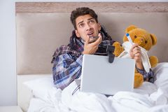 The sick man suffering from flu in the bed. Sick man suffering from flu in the bed Stock Photography
