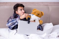 The sick man suffering from flu in the bed. Sick man suffering from flu in the bed Stock Photos