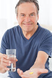 Sick man taking his pills Royalty Free Stock Image