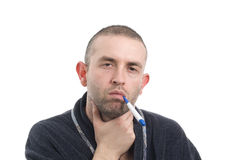 Sick man with thermometer 4 Stock Photos