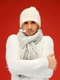Sick man with thermometer in his mouth Royalty Free Stock Photography