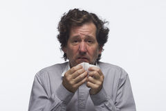 Sick man with tissue, horizontal Stock Photos