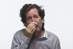 Sick man with tissue, horizontal Royalty Free Stock Photo