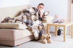 Sick man with tissue Stock Photos