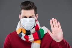 sick man in warm scarf and medical mask with stop sign, Stock Image