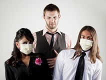 Sick man and worried coworkers in masks Royalty Free Stock Images