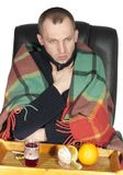 Sick man wrapped in a blanket Stock Photos