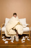 Sick man wrapped in blanket Stock Photography