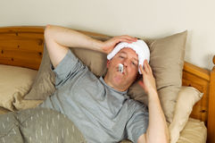 Sick Mature Man with Fever Royalty Free Stock Photography
