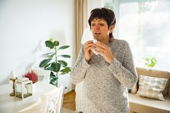 Sick mature woman catch cold. Stock Images