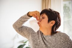 Sick mature woman catch cold. Stock Photos