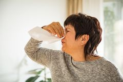 Sick mature woman catch cold. Royalty Free Stock Photo