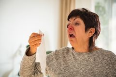 Sick mature woman catch cold. Royalty Free Stock Images