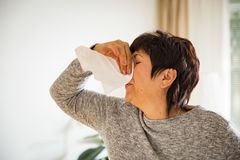 Sick mature woman catch cold. Royalty Free Stock Photos