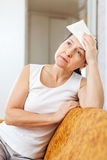 Sick mature woman uses handkerchief Royalty Free Stock Photography