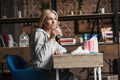 sick middle aged woman drinking water while sitting royalty free stock photography