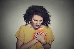 Sick middle aged woman with heart attack, pain Stock Images