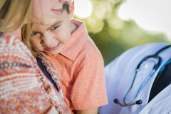 Sick Mixed Race Boy, Mother and Hispanic Doctor Outdoors Stock Photos
