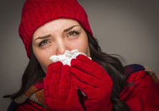 Sick Mixed Race Woman Blowing Her Sore Nose With Tissue Stock Images
