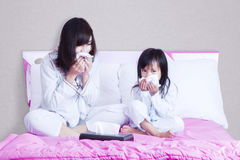 Sick mother and child wiping their nose Royalty Free Stock Photo