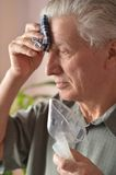 Sick old man Stock Images