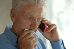 Sick old man calling doctor Royalty Free Stock Photo