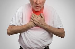 Sick old man, elderly guy, having severe infection, chest pain Royalty Free Stock Photography