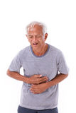 Sick old man suffering from diarrhea, indigestive problem Stock Photo