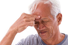 Sick old man suffering from headache, migraine Stock Image