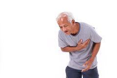 Sick old man suffering from heart attack or breathing difficulties. White isolated background stock image