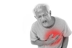 Sick old man suffering from heart attack Stock Photography
