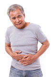 Sick old man suffering from stomachache, diarrhea, indigestive p. Roblem, white isolated background Stock Photos