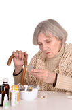 Sick old woman with a cane Stock Image