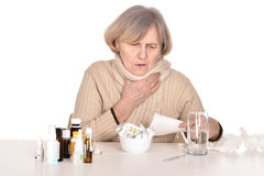 Sick old woman coughs Stock Image