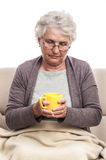 Sick old woman cup of tea Stock Image
