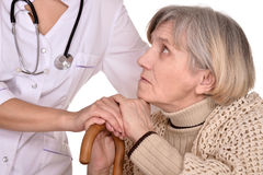Sick old woman with a doctor Stock Photo