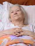 Sick old woman Royalty Free Stock Photos