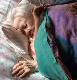 Sick old woman. Lying in bed Stock Photo