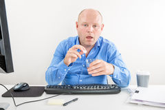 Sick and overworked office worker taking pill Stock Photography