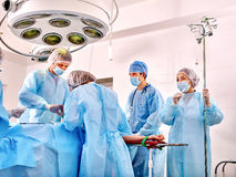 Sick patient on gurney in operating room Stock Photos