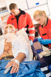 Sick patient with paramedic in ambulance treatment Royalty Free Stock Image