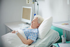 Sick pensioner Stock Images
