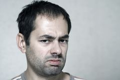 Sick person. Sick caucasian young unshaved man Stock Images