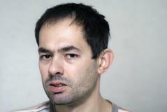 Sick person. Sick caucasian young unshaved man Stock Photos