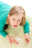 Sick person assorting pills. Young very sick woman taking her huge dose of pills Stock Photography